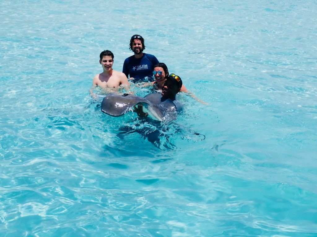 Swim with Stingrays with Five Star Charters Grand Cayman